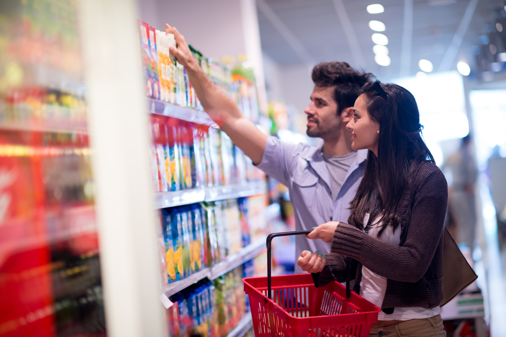 Young couple shopping in a supermarket-1